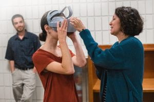 A penn state new kensington student tries on a virtual reality headset