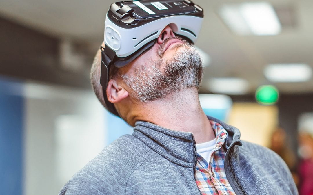 man looking up while wearing a 360-degree video headset